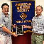 Michael Stephan accepts a plaque of appreciation from Mike Barnett, AWS Mobile Section 2nd Vice Chair.